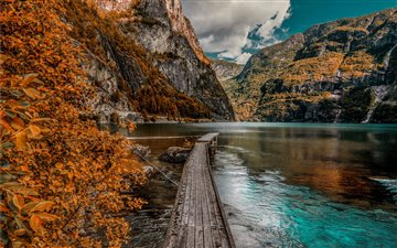 brown wooden dock near mountain during daytime iMac wallpaper