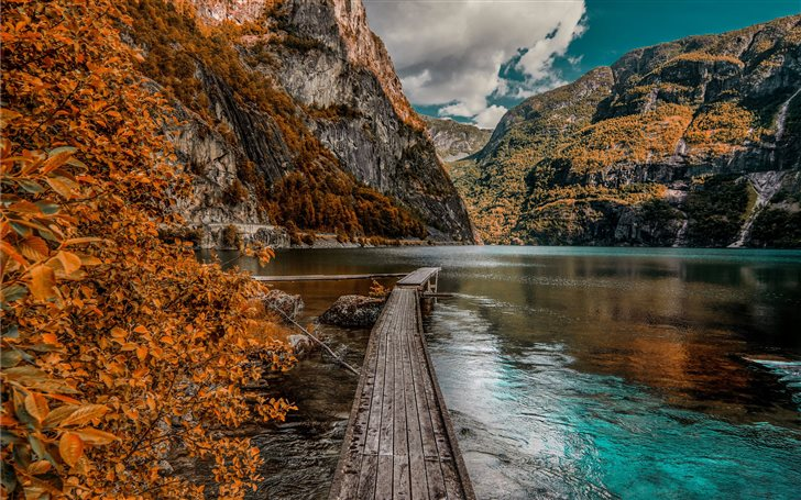 brown wooden dock near mountain during daytime Mac Wallpaper