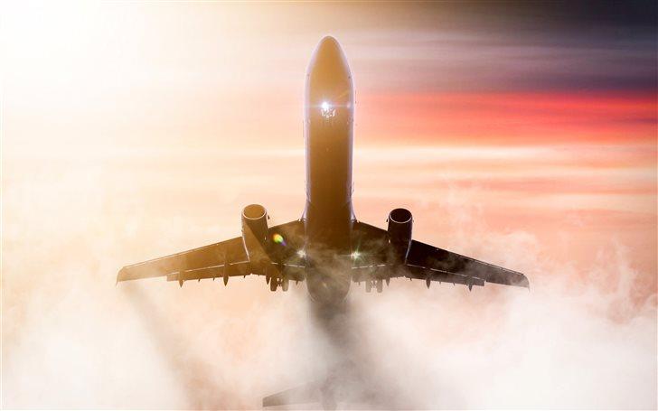 brown airplane during daytime Mac Wallpaper