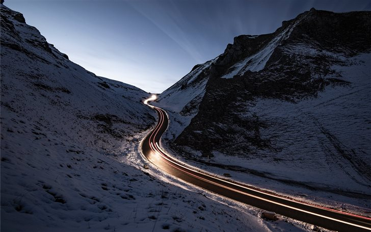 curvy road in middle of snow covered mountain Mac Wallpaper