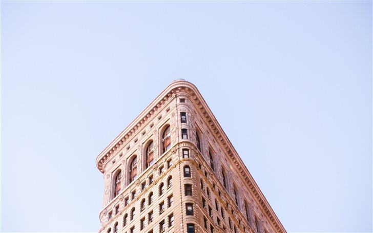 low angle photo of concrete building Mac Wallpaper