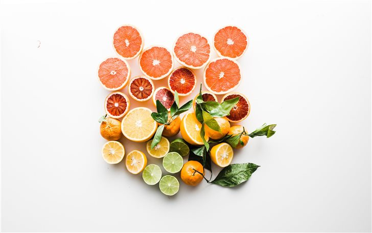 sliced fruit on white surface Mac Wallpaper