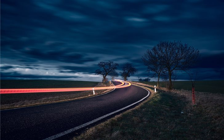 timelapse photography of road and bare trees Mac Wallpaper