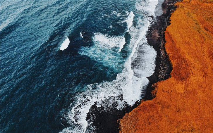 bird's eye view photography of beach line Mac Wallpaper
