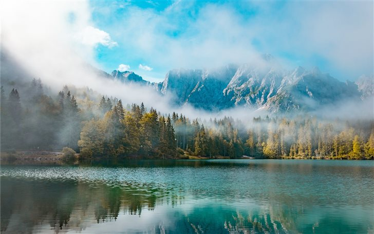 mountain covered with fog digital wallpaper Mac Wallpaper