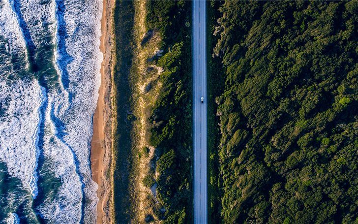 aerial photography of concrete road between trees  Mac Wallpaper