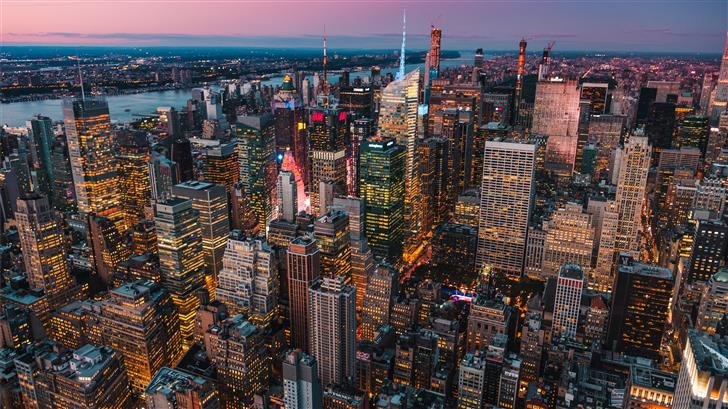 lighted high rise buildings during golden hour Mac Wallpaper