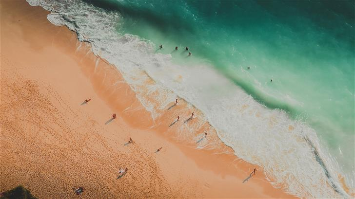 aerial photography of people at the beach Mac Wallpaper