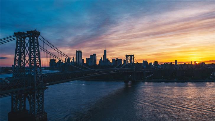 suspension bridge under cloudy sky Mac Wallpaper
