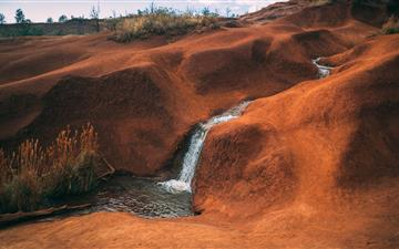 water flowing on brown hill All Mac wallpaper