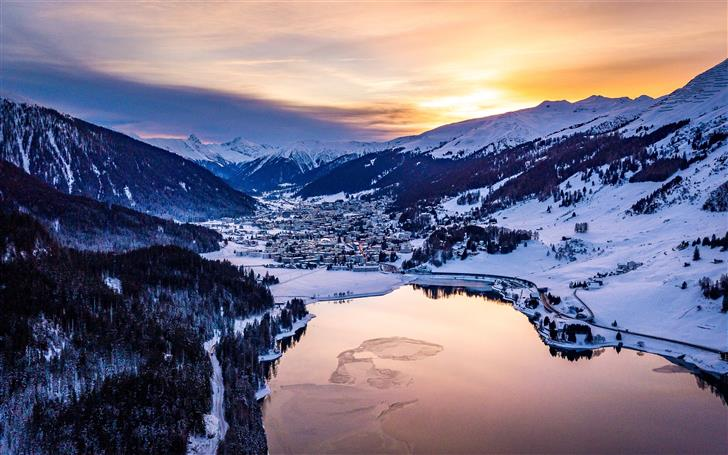 body of water near mountain covered by snow Mac Wallpaper