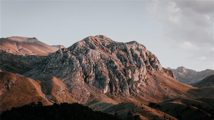 aerial photography of brown and gray mountain rang Mac Wallpaper
