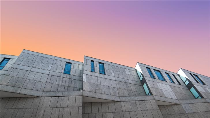 low angle photography of buildings Mac Wallpaper
