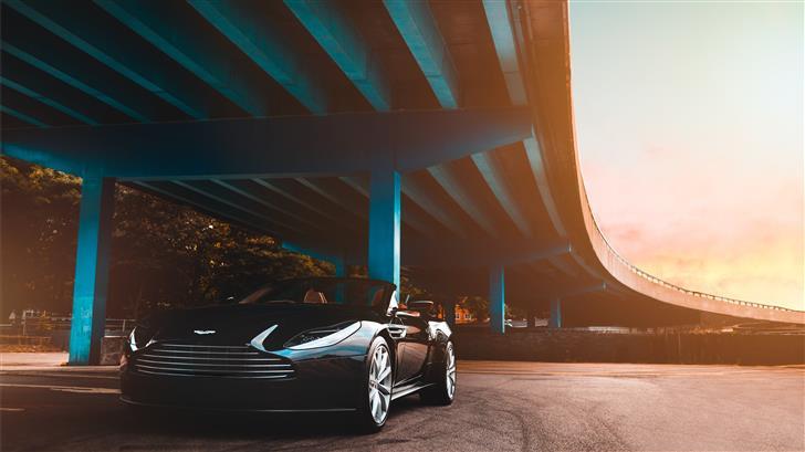 black Aston Martin convertible coupe parked beside Mac Wallpaper