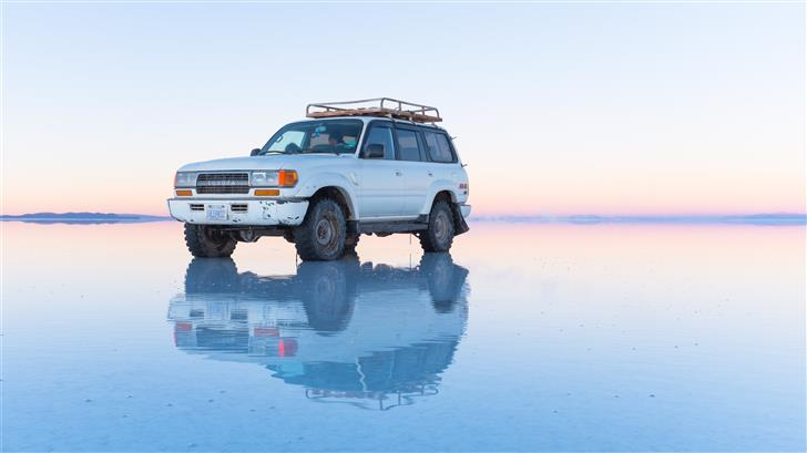 white SUV parked on body of water Mac Wallpaper