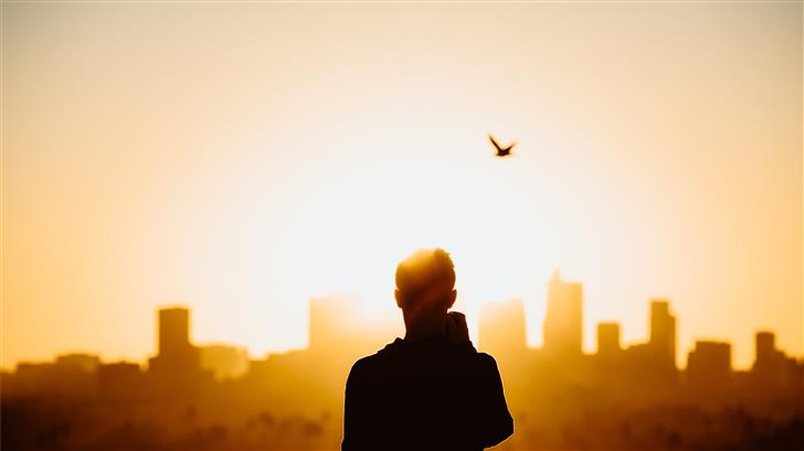 silhouette photography of person during sunrise Mac Wallpaper