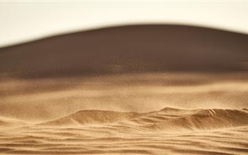 brown sand in closeup photography MacBook Air wallpaper