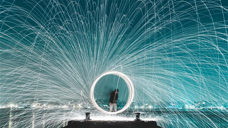 man standing on dock steel wool photography Mac Wallpaper