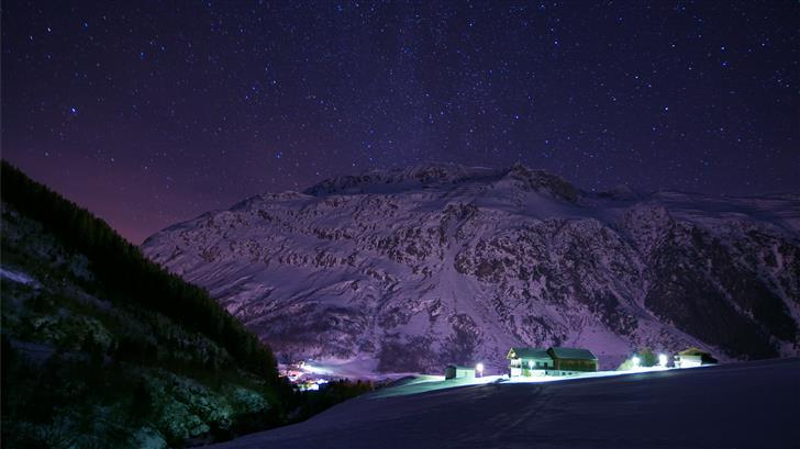 houses near snowcapped mountains Mac Wallpaper