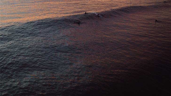 few people on body of water Mac Wallpaper
