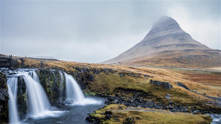 waterfalls near mountains during daytime Mac Wallpaper