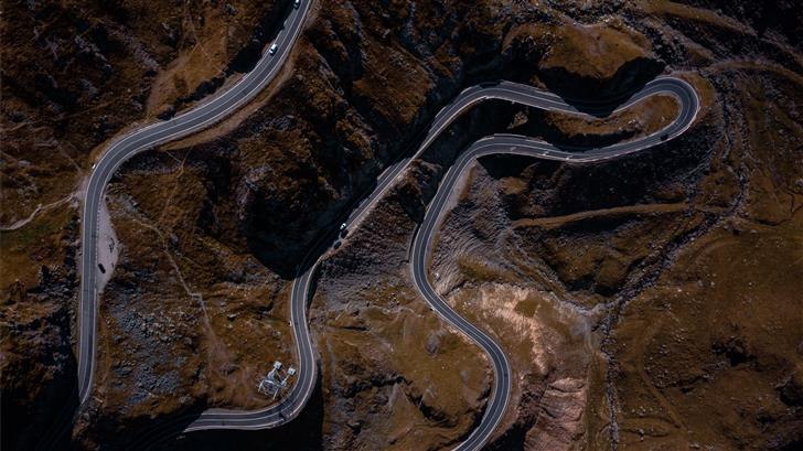 aerial photography of zig zag road Mac Wallpaper