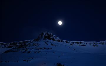 mountain covered with snow during night time All Mac wallpaper