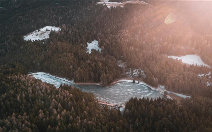 birds eye photography of body of water near forest Mac Wallpaper