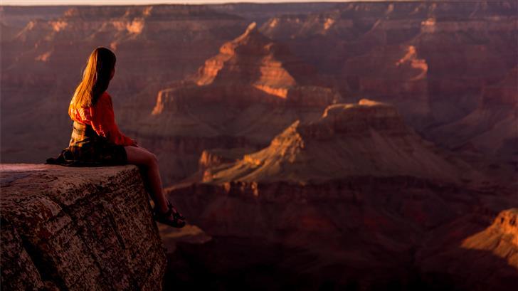 woman on rock edge Mac Wallpaper