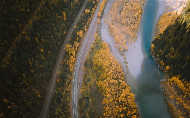 aerial photography of farm road beside river Mac Wallpaper