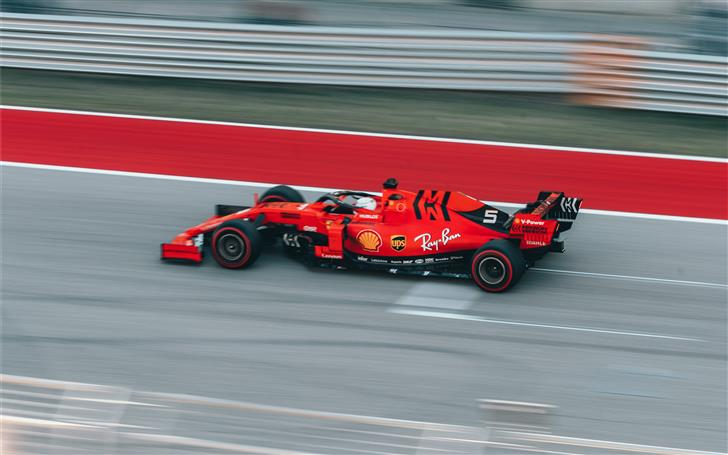 selective focus photography of red Formula 1 on tr Mac Wallpaper