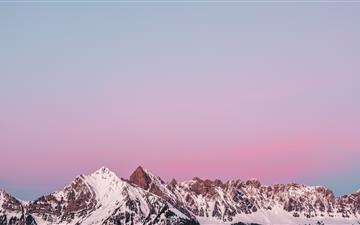 Lovely sunset behind a snowy mountain in Flums Swi All Mac wallpaper