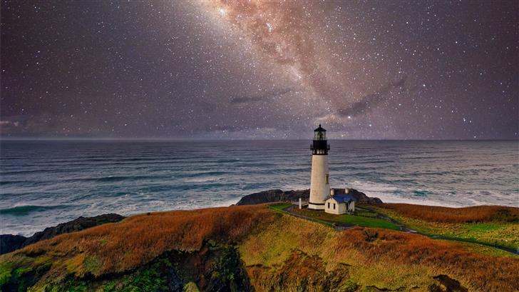 lighthouse under starry night Mac Wallpaper