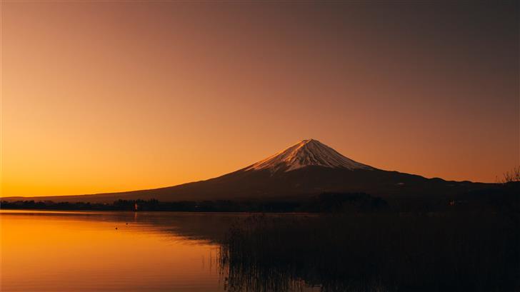 silhouette photography of mountain near lake durin Mac Wallpaper