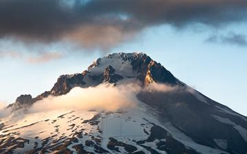 snow covered mountain under cloudy sky during dayt MacBook Pro wallpaper