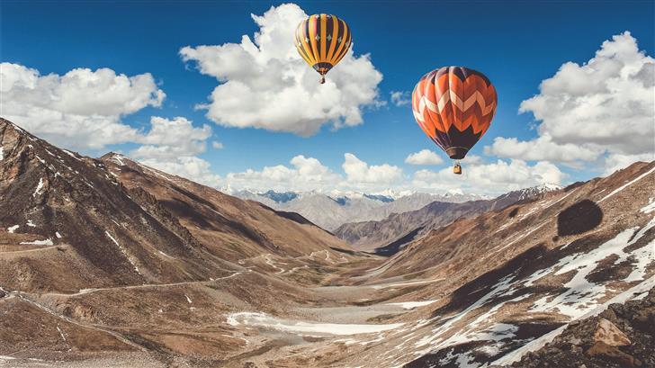 two hot air balloons floating Mac Wallpaper