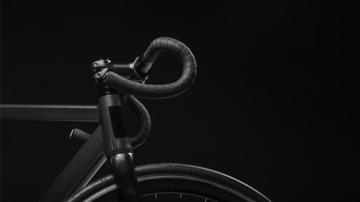 black road bicycle handle with black background Mac Wallpaper
