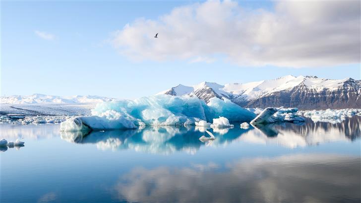 ice bergs and alp mountains facing calm body of wa Mac Wallpaper