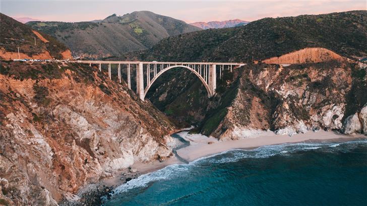 gray bridge over blue sea during daytime Mac Wallpaper