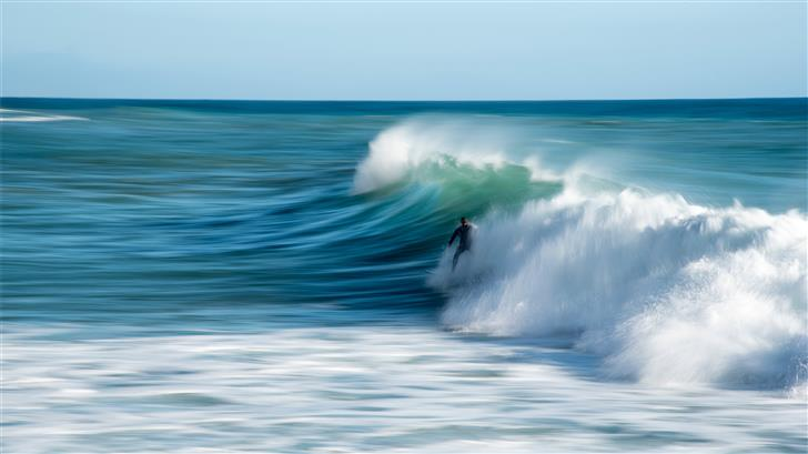 person riding surfboard Mac Wallpaper