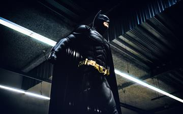 Batman standing under steel roof All Mac wallpaper