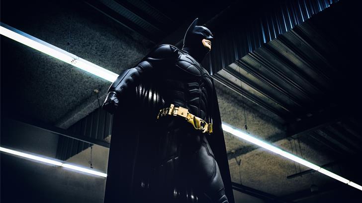 Batman standing under steel roof Mac Wallpaper