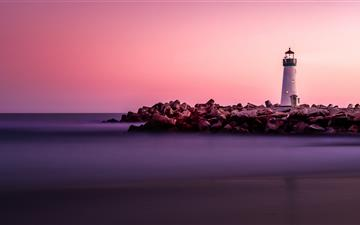 white lighthouse on rocky seashore MacBook Air wallpaper