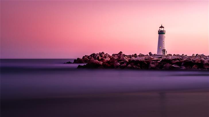 white lighthouse on rocky seashore Mac Wallpaper