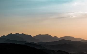 silhouette of mountain during golden hour iMac wallpaper