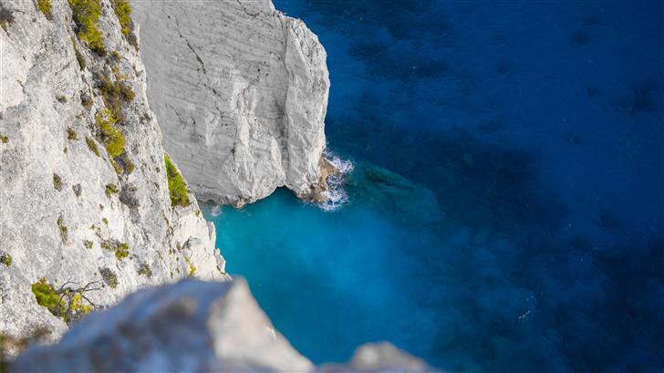 white and green cliff beside ocean Mac Wallpaper