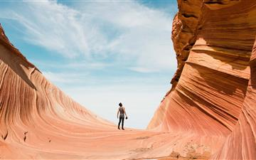 man on antelope canyon during daytime iMac wallpaper