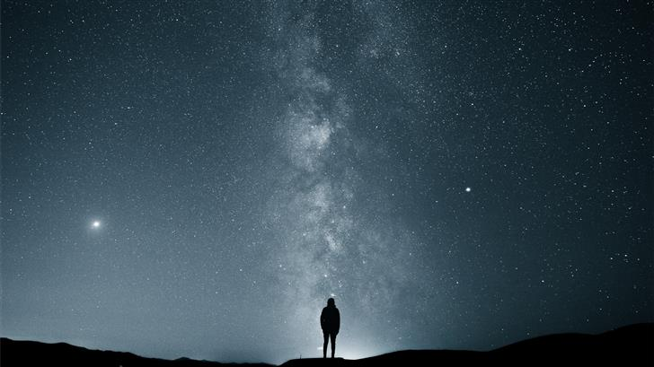 silhouette of person under starry sky Mac Wallpaper