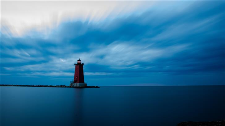 red and white lighthouse on top of hill Mac Wallpaper