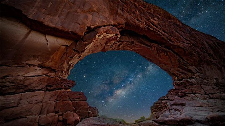 mountain cliff under starry night Mac Wallpaper